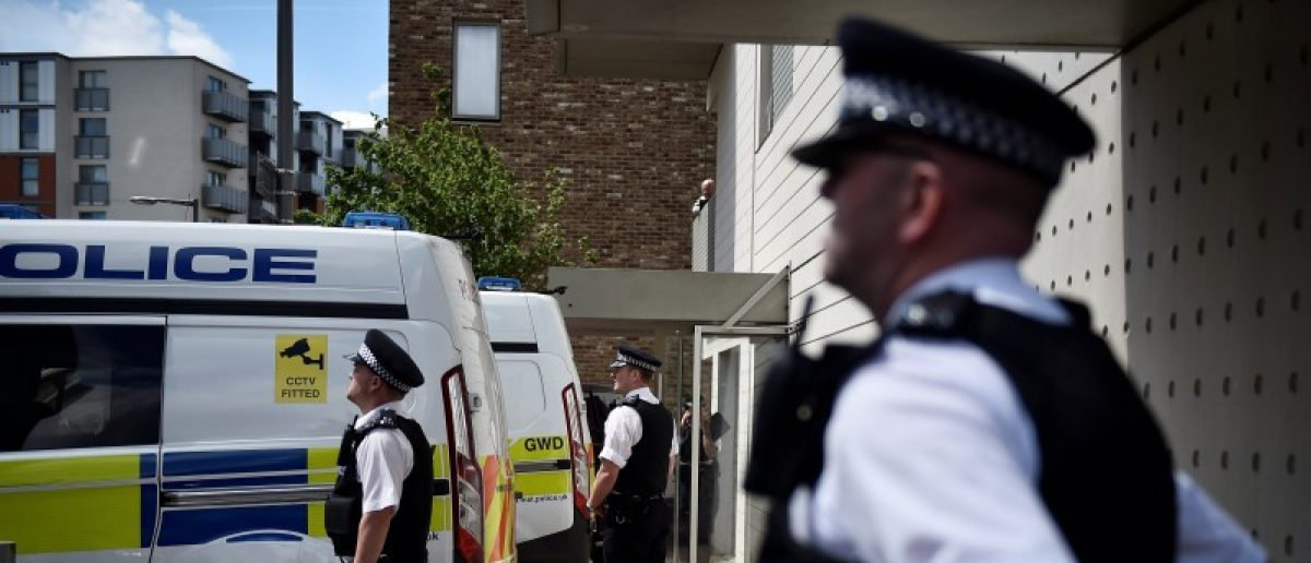 Officers and vehicles stand outside a block of flats that was raided by police in Barking, east London, Britain, June 4, 2017. REUTERS/Hannah McKay