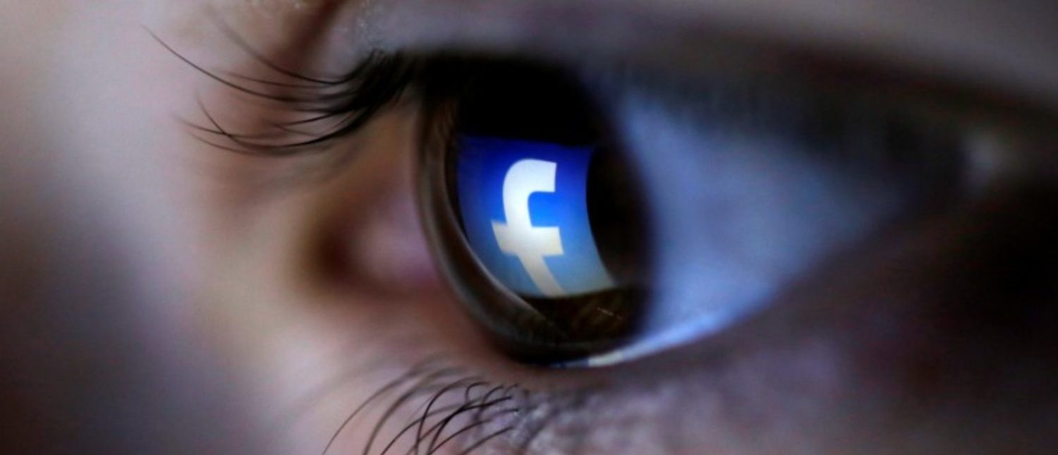FILE PHOTO: A picture illustration shows a Facebook logo reflected in a person's eye, in Zenica, March 13, 2015. REUTERS/Dado Ruvic/Illustration/File Photo
