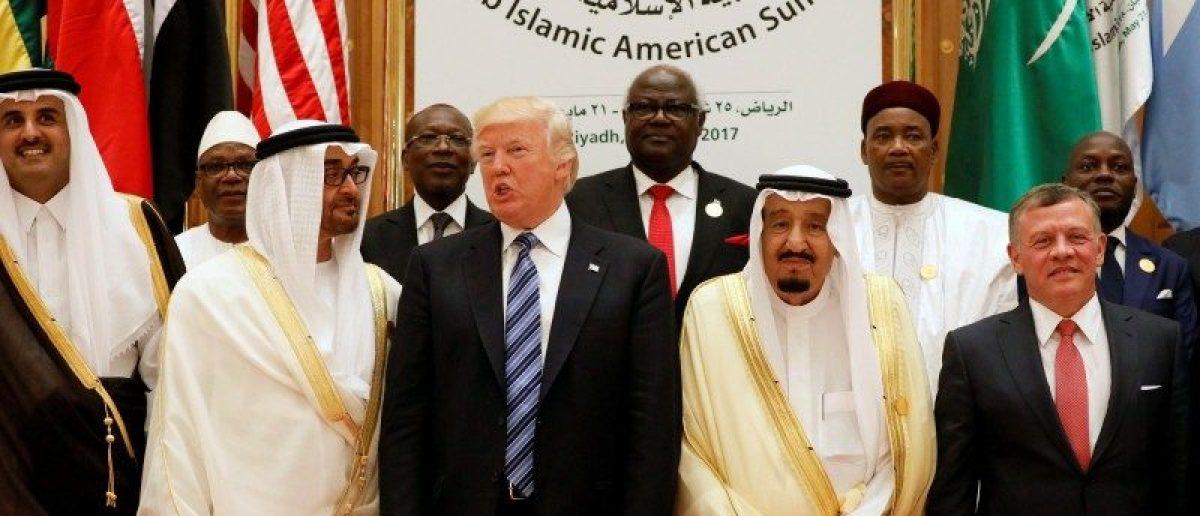 FILE PHOTO: (Front R-L) Jordan's King Abdullah II, Saudi Arabia's King Salman bin Abdulaziz Al Saud, U.S. President Donald Trump, Abu Dhabi Crown Prince Sheikh Mohammed bin Zayed al-Nahyan and Qatar's Emir Sheikh Tamim Bin Hamad Al-Thani pose for a photo during Arab-Islamic-American Summit in Riyadh, Saudi Arabia May 21, 2017. REUTERS/Jonathan Ernst/File Photo