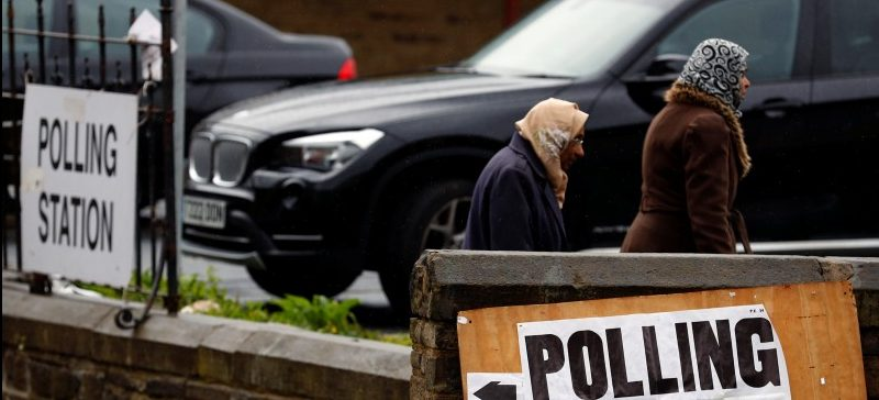 Voters walk past a polling station in Bradford, Britain June 8, 2017. REUTERS/Phil Noble