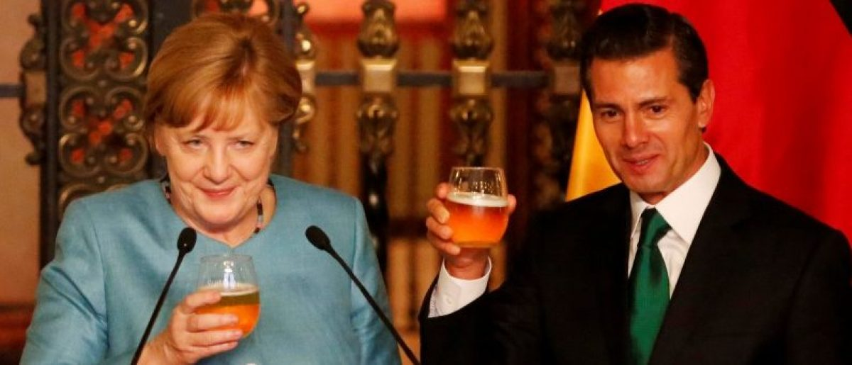 Germany's Chancellor Angela Merkel gestures as she makes a toast with Mexico's President Enrique Pena Nieto before dinner at National Palace in Mexico City, Mexico June 9, 2017. REUTERS/Carlos Jasso