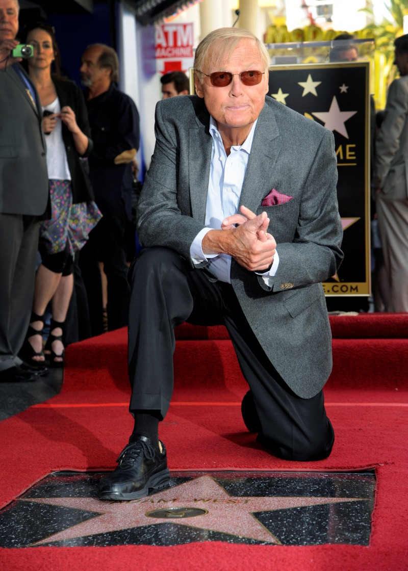 FILE PHOTO: Actor Adam West poses with his star on the Hollywood Walk of Fame in Los Angeles April 5, 2012. REUTERS/Phil McCarte/File Photo