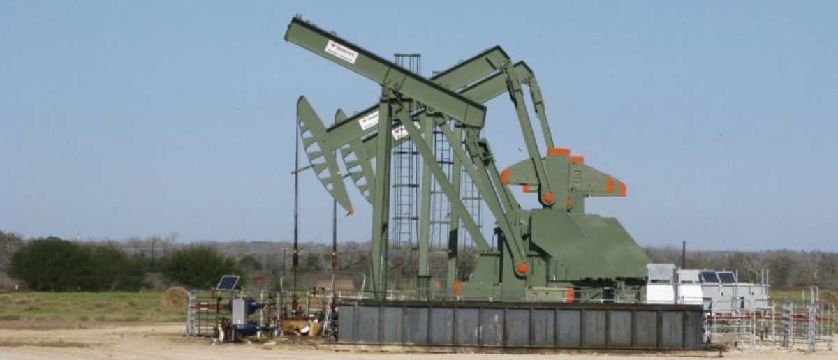 FILE PHOTO - A pump jack used to help lift crude oil from a well in South Texas' Eagle Ford Shale formation stands idle in Dewitt County Texas
