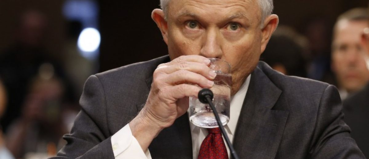 U.S. Attorney General Jeff Sessions takes a drink prior to testifying before a Senate Intelligence Committee hearing on Capitol Hill in Washington, U.S., June 13, 2017. REUTERS/Jonathan Ernst