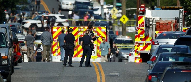 Police survey a shooting scene after a gunman opened fire on Republican members of Congress during a baseball practice near Washington in Alexandria, Virginia, June 14, 2017. REUTERS/Joshua Roberts