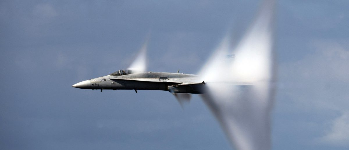 PACIFIC OCEAN (June 6, 2011) An F/A-18C Hornet assigned to Strike Fighter Squadron (VFA) 113 breaks the sound barrier during an air power demonstration over the Nimitz-class aircraft carrier USS Carl Vinson (CVN 70). Carl Vinson and Carrier Air Wing (CVW) 17 are currently underway in the U.S. 7th Fleet area of responsibility. (U.S. Navy photo by Mass Communication Specialist 3rd Class Travis K. Mendoza/Released)