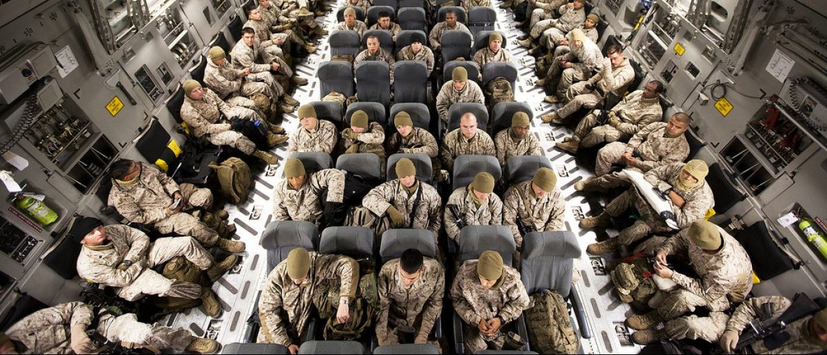 """MANAS AIR BASE, Kyrgyzstan — Marines and sailors with Headquarters and Service Company, 3rd Battalion, 3rd Marine Regiment, sit aboard an Air Force C-17 transport aircraft on the flight line here, before departing for Camp Dwyer, Afghanistan, Oct. 30. After departing from Hawaii from Oct. 27 through Nov. 1, """"America's Battalion"""" arrived in southern Helmand province to begin their seven-month deployment in support of Operation Enduring Freedom. In the coming weeks 3/3 will take control of operations in Garmsir District, relieving fellow Hawaii-based 1st Battalion, 3rd Marine Regiment. The """"Lava Dogs"""" of 1/3 are nearing the end of their deployment, which began in April. (Official U.S. Marine Corps photo by Cpl. Reece Lodder / RELEASED)"""