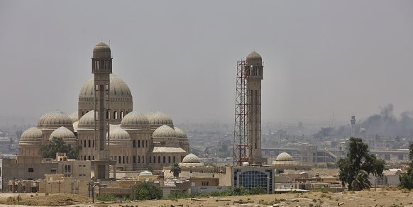 The al-Nuri mosque with its iconic 'leaning' minaret, before it was detonated by retreating ISIL forces. (Photo by Noe Falk Nielsen/NurPhoto via Getty Images)
