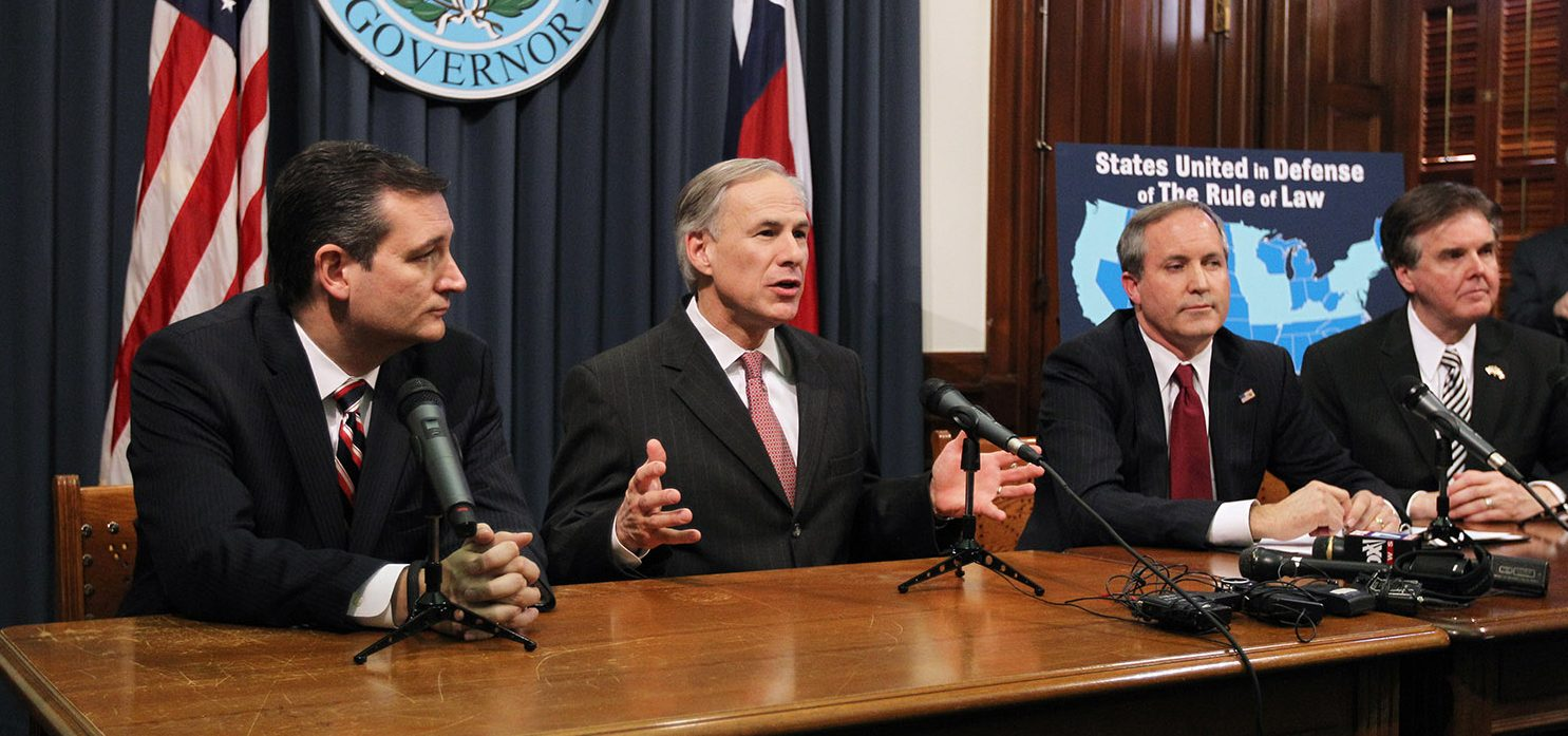 Texas Governor Greg Abbott (2nd L) speaks alongside U.S. Sen. Ted Cruz (R-TX) (L), Attorney General Ken Paxton (2nd R), Lieutenant Governor Dan Patrick (R) hold a joint press conference February 18, 2015 in Austin, Texas. The press conference addressed the United States District Court for the Southern District of Texas' decision on the lawsuit filed by a Texas-led coalition of 26 states challenging President Obama's executive action on immigration. (Photo by Erich Schlegel/Getty Images)