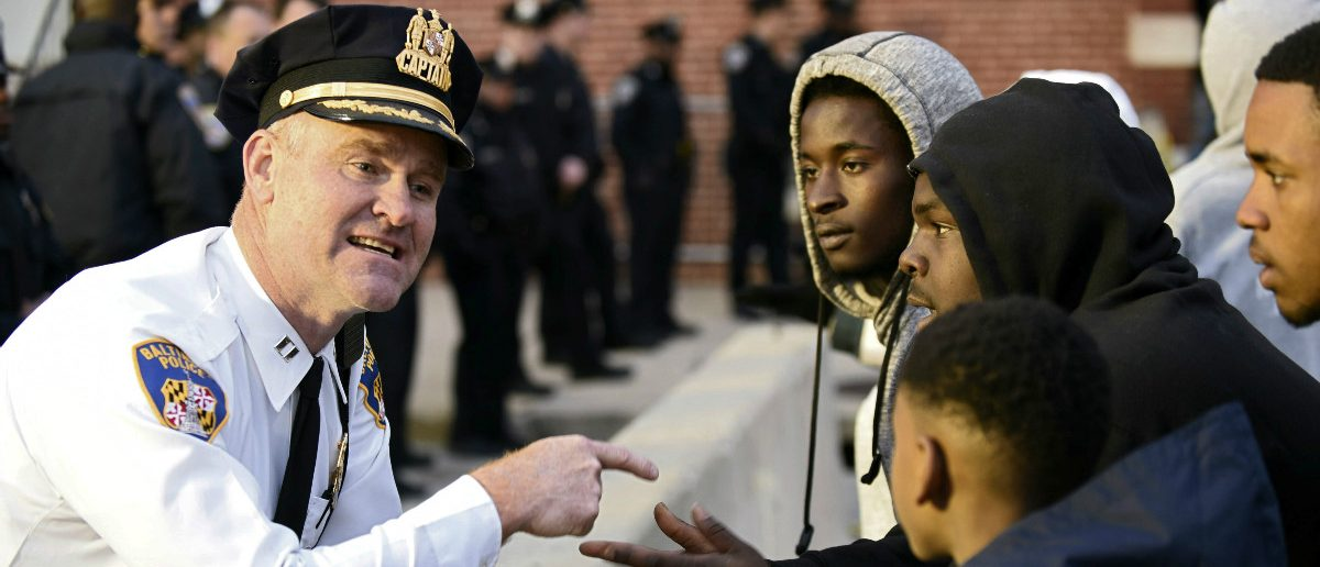 Captain Erik Pecha of the Baltimore Police Department chats with demonstrators in front of the Baltimore Police Department Western District station during a protest against the death in police custody of Freddie Gray in Baltimore April 23, 2015. (Sait Serkan Gurbuz/Reuters)