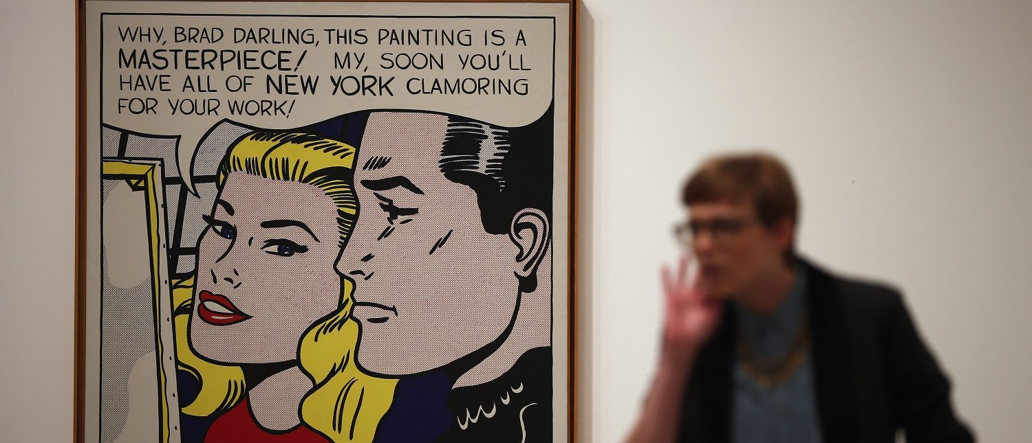 LONDON, ENGLAND - FEBRUARY 18: A visitor stands in front of a painting entitled 'Masterpiece,' during a press preview of 'Lichtenstein, a Retrospective' at the Tate Modern on February 18, 2013 in London, England. The painting is part of a retrospective exhibition by 1960's Pop Artist Roy Lichtenstein, the first of its kind in 20 years, which runs at the gallery until May 27, 2013. (Photo by Dan Kitwood/Getty Images)