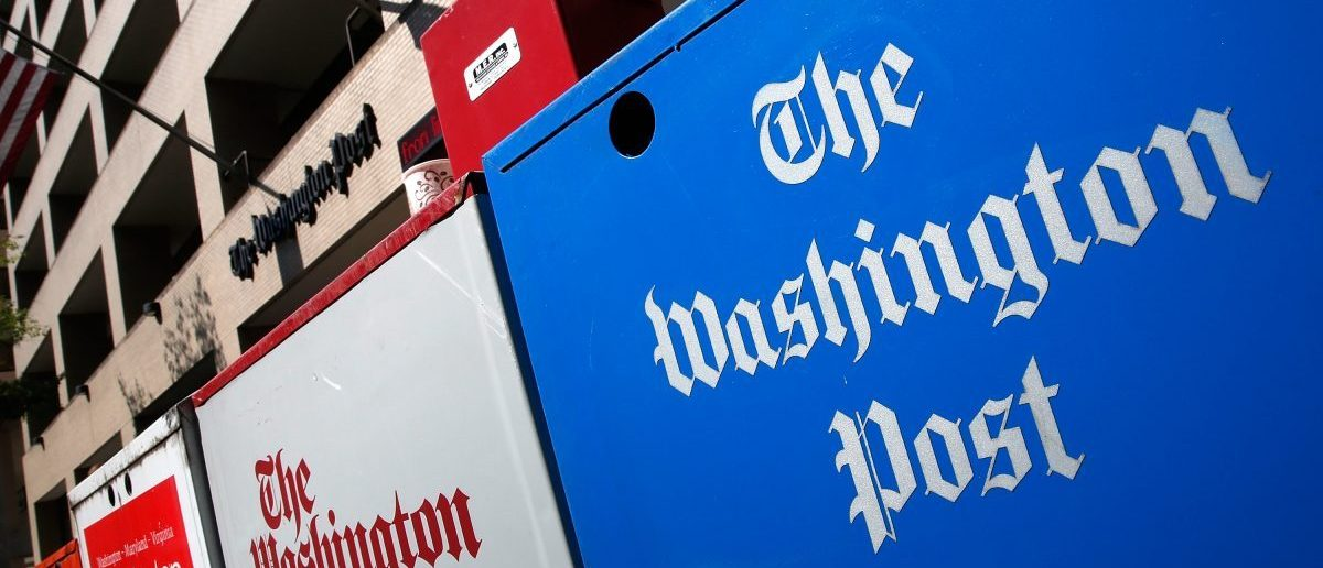 Newspaper boxes stand outside the Washington Post building September 2, 2014 in Washington, DC. (Win McNamee/Getty Images)