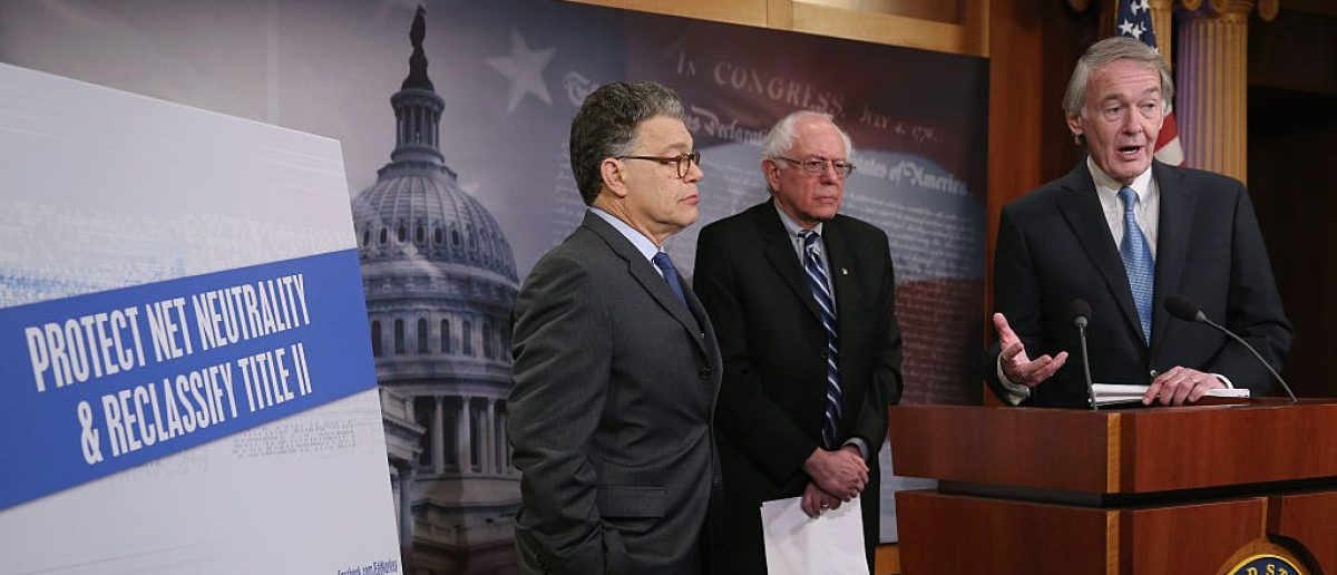 WASHINGTON, DC - FEBRUARY 04: Sen. Edward Markey (D-MA) (R) talks about net neutrality while flanked by Sen. Bernie Sanders (I-VT) (C), and Sen. Al Franken (D-MN), and during a news conference on Capitol Hill, February 4. 2015 in Washington, DC. Senate Democrats are calling on the Federal Communications Commission to reclassify the transmission component of broadband Internet access as a telecommunications service under Title II of the Telecommunications Act. (Photo by Mark Wilson/Getty Images)