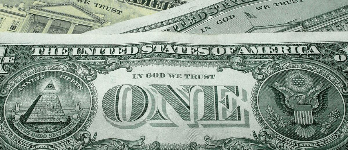 "WASHINGTON - OCTOBER 14:  The words ""In God We Trust"" are seen on U.S. currency October 14, 2004 in Washington, DC. Although the U.S. constitution prohibits an official state religion, references to God appear on American money, the U.S. Congress starts its daily session with a prayer, and the same U.S. Supreme Court that has consistently struck down organized prayer in public schools as unconstitutional opens its public sessions by asking for the blessings of God. The Supreme Court will soon use cases from Kentucky and Texas to consider the constitutionality of Ten Commandments displays on government property, addressing a church-state issue that has ignited controversy around the country.  (Photo Illustration by Alex Wong/Getty Images)"