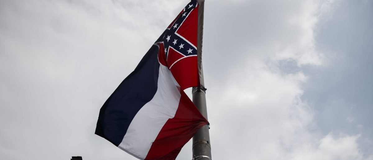 The Mississippi state flag, which features the Confederate flag, hangs as protestors gathered for a sit in, demanding its removal during a protest at the 2016 Democratic National Convention on July 25, 2016 in Philadelphia, Pennsylvania. (Photo credit: PATRICK T. FALLON/AFP/Getty Images)
