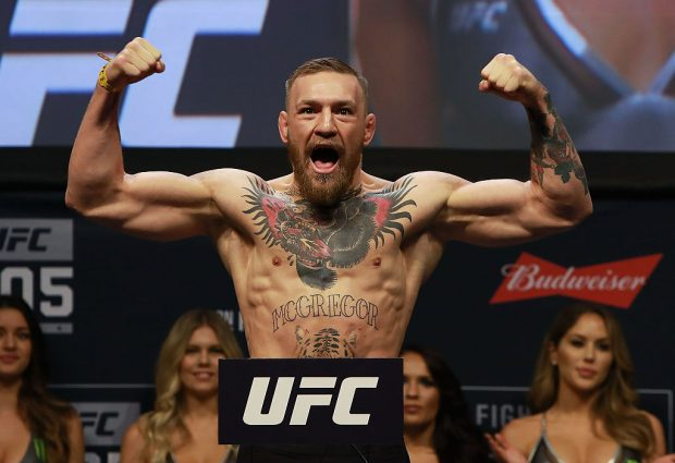 UFC Featherweight Champion Conor McGregor reacts during UFC 205 Weigh-ins at Madison Square Garden on November 11, 2016 in New York City. (Photo by Michael Reaves/Getty Images)