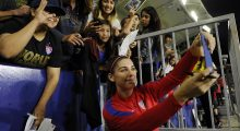 Alex Morgan takes a selfie with fans (Photo: Getty)