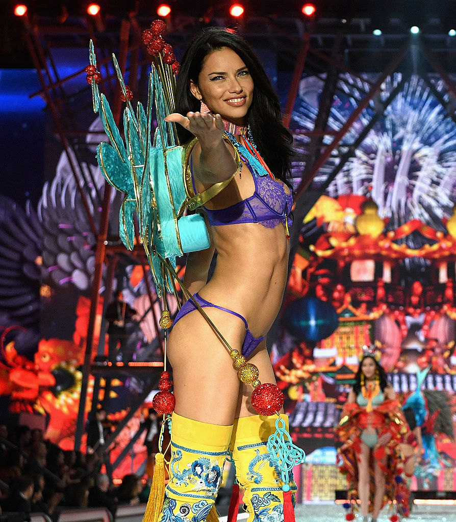 Adriana Lima strikes a pose at the end of the runway. (Photo by Dimitrios Kambouris/Getty Images for Victoria's Secret)