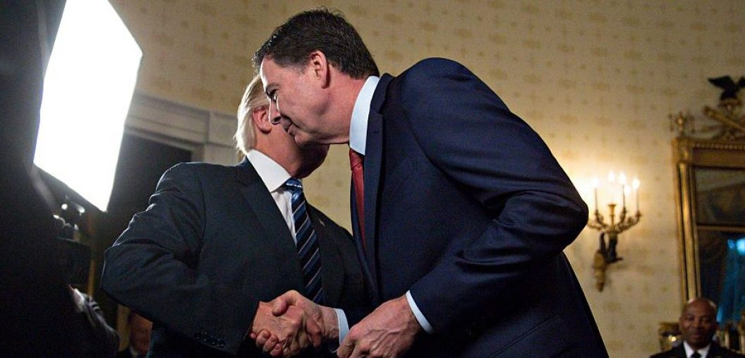 Trump shakes hands with Comey in January 2017. Andrew Harrer-Pool/Getty Images.