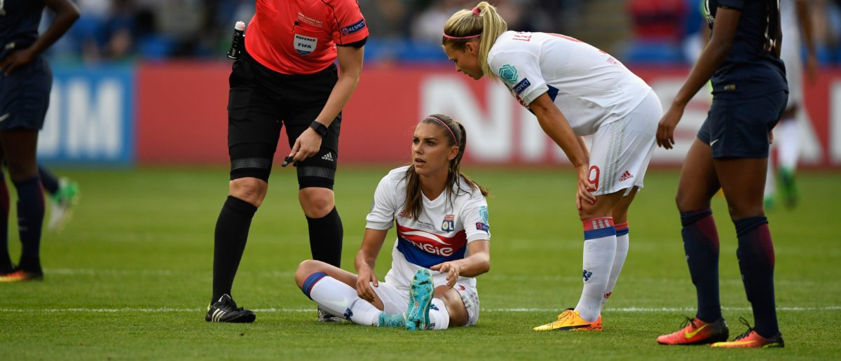 CARDIFF, WALES - JUNE 01:  Lyon forward Alex Morgan reacts after an injury forces her to leave the field during the UEFA Women's Champions League Final between Lyon and Paris Saint Germain at Cardiff City Stadium  on June 1, 2017 in Cardiff, Wales.  (Photo by Stu Forster/Getty Images)