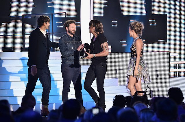 NASHVILLE, TN - JUNE 07: Carrie Underwood and Keith Urban receive award onstage from Ashton Kutcher and Danny Masterson during the 2017 CMT Music Awards at the Music City Center on June 6, 2017 in Nashville, Tennessee. (Photo by Michael Loccisano/Getty Images for CMT)