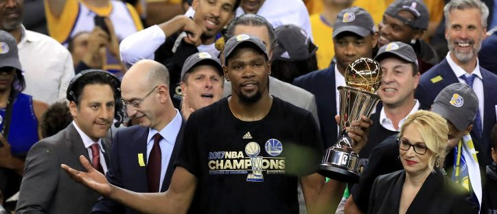 Kevin Durant #35 of the Golden State Warriors celebrates with the Bill Russell NBA Finals Most Valuable Player Award after defeating the Cleveland Cavaliers 129-120 in Game 5 to win the 2017 NBA Finals at ORACLE Arena on June 12, 2017 in Oakland, California. NOTE TO USER: User expressly acknowledges and agrees that, by downloading and or using this photograph, User is consenting to the terms and conditions of the Getty Images License Agreement. (Photo by Ronald Martinez/Getty Images)
