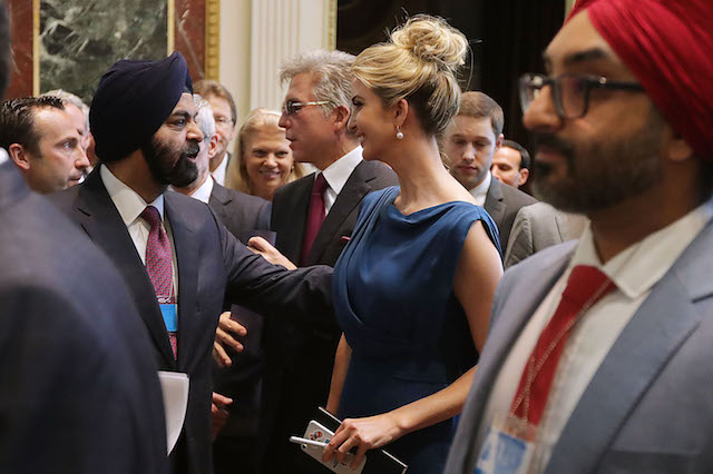 """WASHINGTON, DC - JUNE 19: Master Card CEO Ajay Banga (2nd L) talks with Ivanka Trump during the inaugural meeting of the American Technology Council during the inaugural meeting of the American Technology Council in the Indian Treaty Room at the Eisenhower Executive Office Building next door to the White House June 19, 2017 in Washington, DC. According to the White House, the council's goal is """"to explore how to transform and modernize government information technology."""" (Photo by Chip Somodevilla/Getty Images)"""