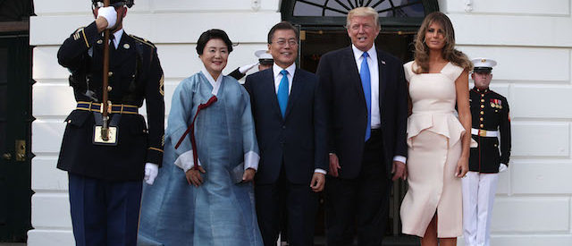 President Donald Trump and first lady Melania Trump welcome South Korean President Moon Jae-in and his wife Kim Jung-sook during an arrival at the South Portico of the White House June 29, 2017 in Washington, D.C. President Moon is on a three-day visit in Washington. (Photo by Alex Wong/Getty Images)