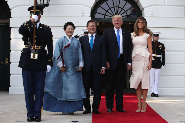 WASHINGTON, DC - JUNE 29: U.S. President Donald Trump (3rd L) and first lady Melania Trump (R) welcome South Korean President Moon Jae-in (2nd L) and his wife Kim Jung-sook (L) during an arrival at the South Portico of the White House June 29, 2017 in Washington, DC. President Moon is on a three-day visit in Washington. (Photo by Alex Wong/Getty Images)