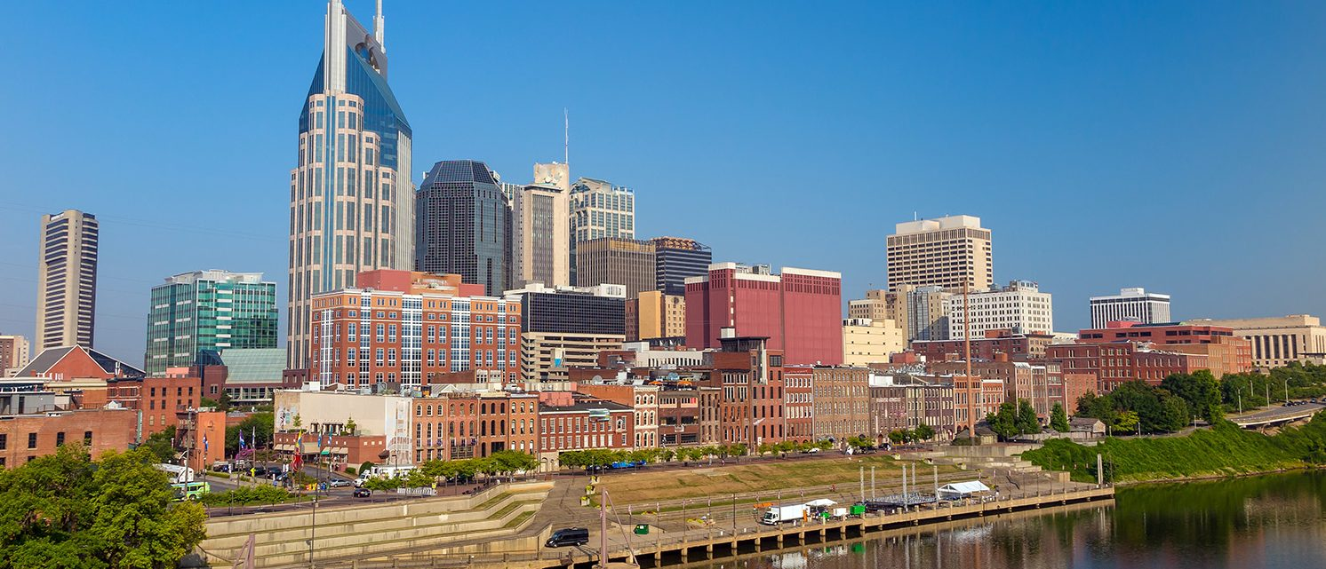 Nashville, Tennessee downtown skyline at Cumberland River. (PHOTO: f11photo/Shutterstock)