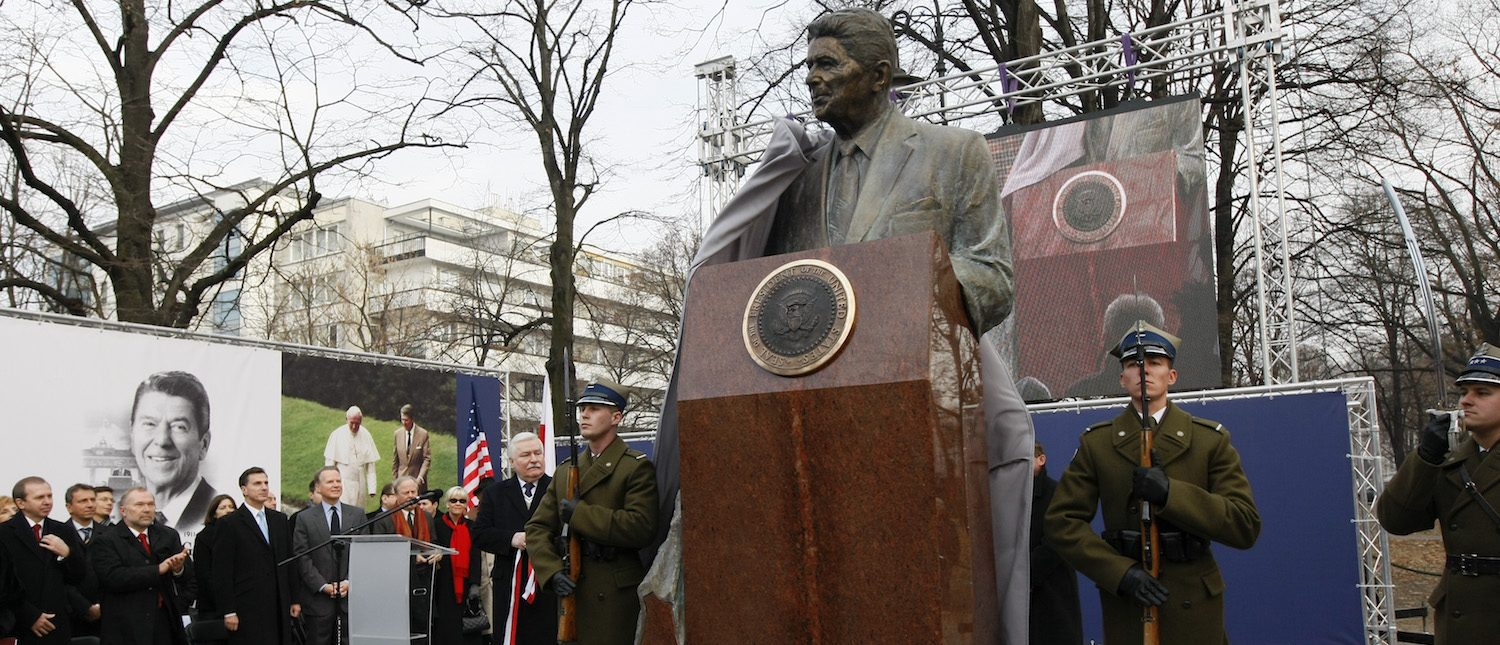 Poland's former president Lech Walesa unveils a statue of former U.S. president Ronald Reagan during a ceremony in Warsaw November 21, 2011. The ceremony was to honour Reagan's role in bringing down communism in central-eastern part of Europe. (REUTERS/Kacper Pempel)