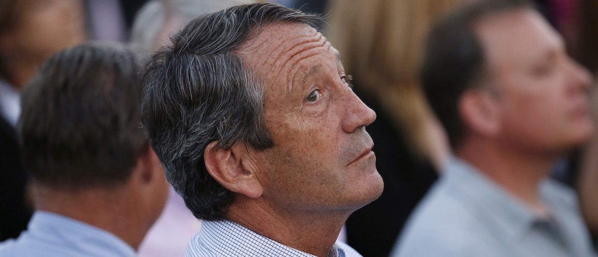 Rep. Mark Sanford (R-SC) looks up while attending a picnic for members of Congress hosted by U.S. President Barack Obama at the White House in Washington September 17, 2014. Sanford and his former wife have agreed to go to mediation over the latest spat arising from their divorce in 2010 after his extramarital affair while serving as the state's governor, a judge said on Monday. REUTERS/Kevin Lamarque (UNITED STATES - Tags: POLITICS) - RTR46NU7