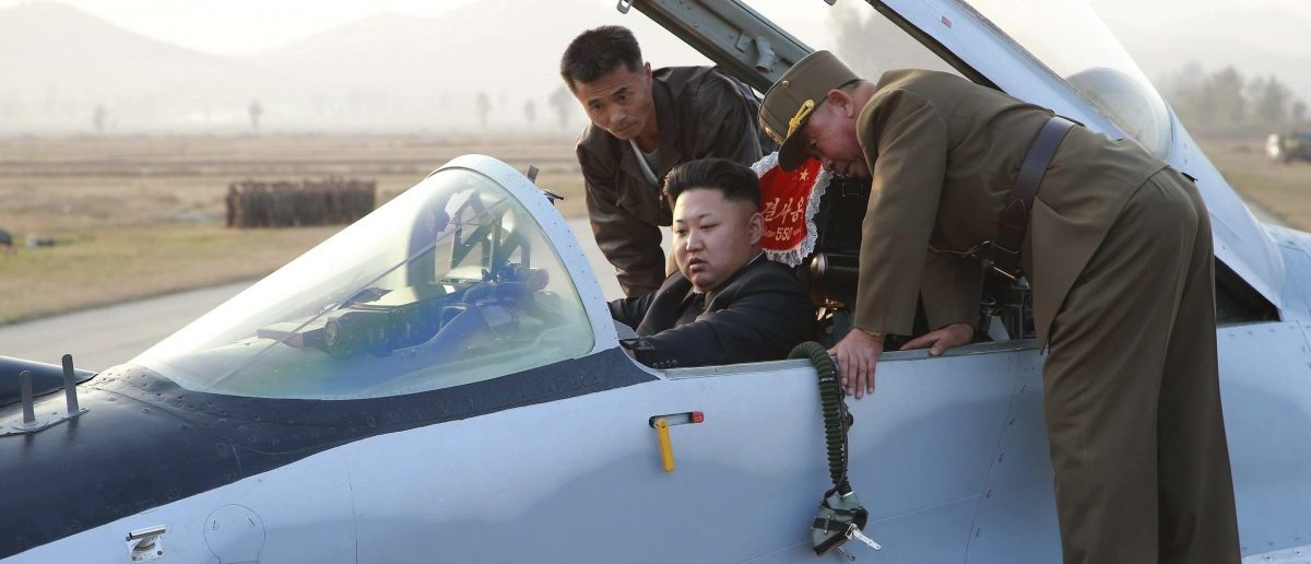 North Korean leader Kim Jong Un sits in an airplane as he guides a flight drill for the inspection of airmen of the Korean People's Army (KPA) Air and Anti-Air Force in this undated photo released by North Korea's Korean Central News Agency (KCNA) in Pyongyang October 30, 2014. REUTERS/KCNA