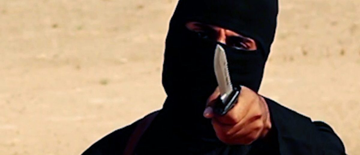 """A masked, black-clad militant, who has been identified by the Washington Post newspaper as a Briton named Mohammed Emwazi, brandishes a knife in this still image from a 2014 video obtained from SITE Intel Group February 26, 2015. Investigators believe that the masked killer known as """"Jihadi John"""", who fronted Islamic State beheading videos, is Emwazi, two U.S. government sources said on Thursday. The British government and police refused to confirm or deny his identity, which was first revealed by the Washington Post, saying it was an ongoing security investigation. REUTERS/SITE Intel Group/Handout via Reuters (CIVIL UNREST POLITICS CRIME LAW CONFLICT) ATTENTION EDITORS - THIS PICTURE WAS PROVIDED BY A THIRD PARTY. REUTERS IS UNABLE TO INDEPENDENTLY VERIFY THE AUTHENTICITY, CONTENT, LOCATION OR DATE OF THIS IMAGE. FOR EDITORIAL USE ONLY. NOT FOR SALE FOR MARKETING OR ADVERTISING CAMPAIGNS. THIS PICTURE WAS PROCESSED BY REUTERS TO ENHANCE QUALITY. AN UNPROCESSED VERSION WILL BE PROVIDED SEPARATELY - RTR4RC07"""