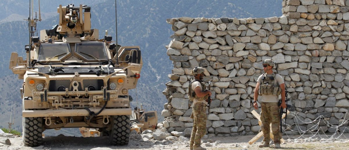 U.S. soldiers stand guard near the site of a U.S. bombing in the Achin district of Nangarhar province in eastern Afghanistan April 15, 2017. (Reuters)