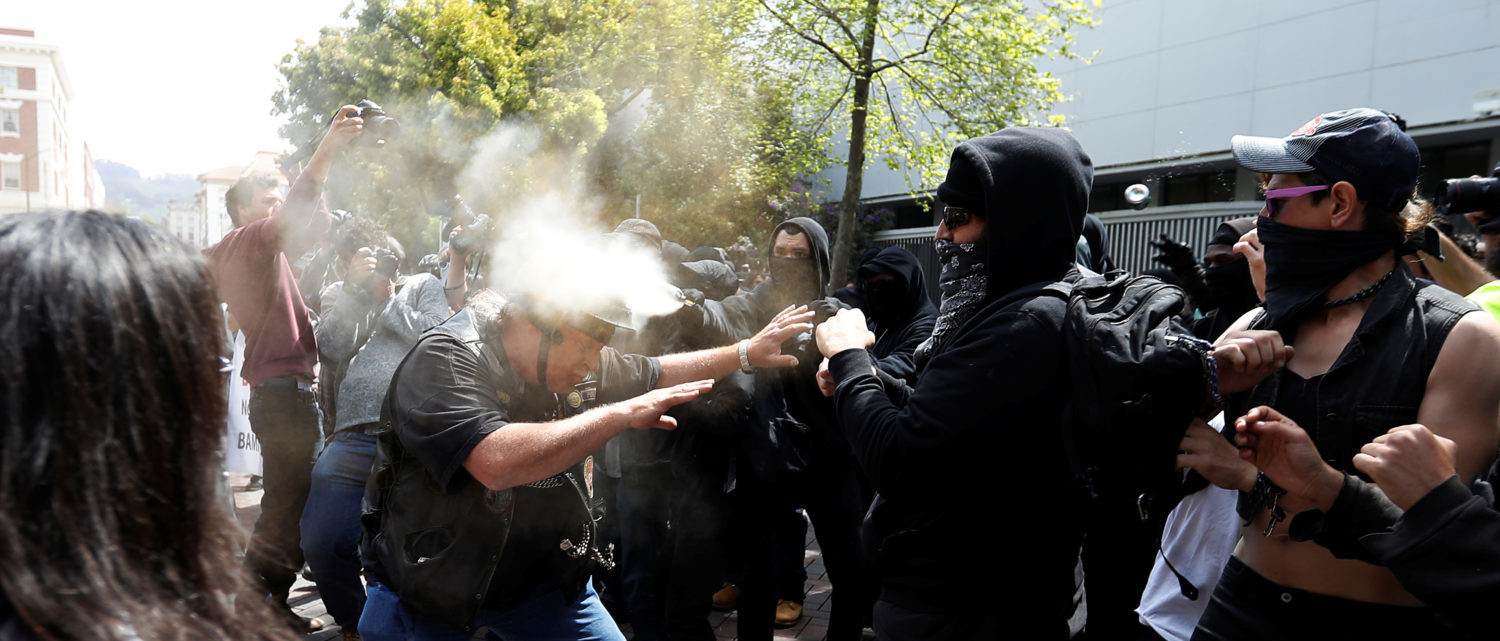 A man in support of U.S. President Donald Trump (L) is being pepper-sprayed by a counter-protester during a rally in Berkeley, California in Berkeley, California, U.S., April 15, 2017. (Photo: REUTERS/Stephen Lam)