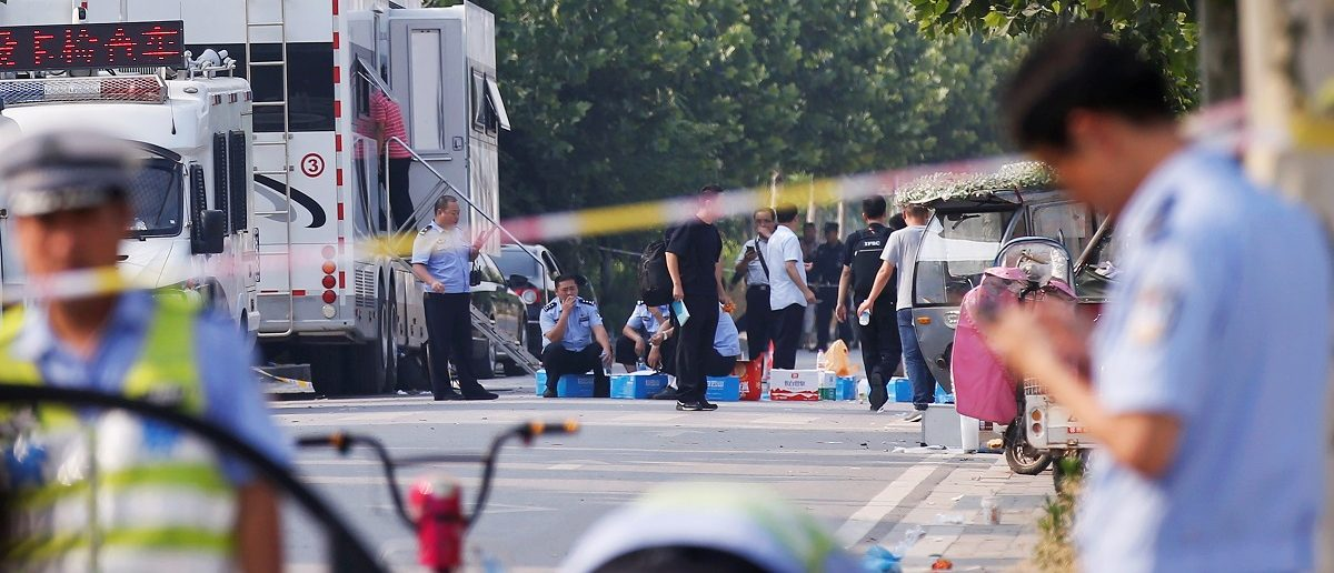 Security personnel gather at the scene of an explosion at a kindergarten in Fengxian County in Jiangsu Province, China June 16, 2017. REUTERS/Aly Song