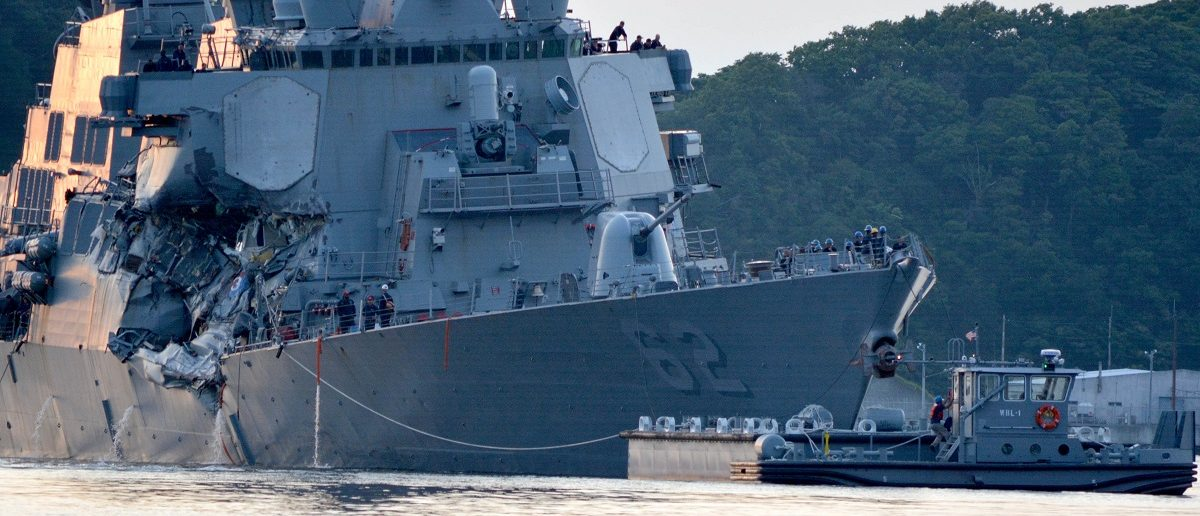 The U.S. Navy Arleigh Burke-class guided-missile destroyer USS Fitzgerald returns to Fleet Activities (FLEACT) Yokosuka following a collision with a merchant vessel while operating southwest of Yokosuka, Japan in photo received June 17, 2017.  Courtesy of U.S. Navy/Mass Communication Specialist 1st Class Peter Burghart/Handout via REUTERS
