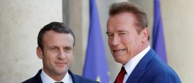 Former California Governor Arnold Schwarzenegger (R) is greeted by French President Emmanuel Macron (L) upon his arrival at the Elysee Palace in Paris, France, June 23, 2017.   (REUTERS/Charles Platiau )