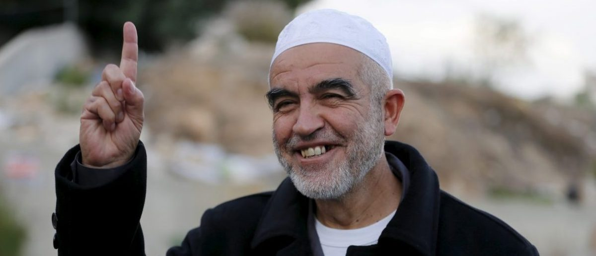 Sheikh Raed Salah, leader of the The Islamic Movement northern branch in Israel poses for a photo after Israel outlawed the Movement today in Nazareth, November 17, 2015. Israel on Tuesday outlawed an Islamist group it says has played a central role in stirring up violence over a Jerusalem holy site in a wave of bloodshed that began seven weeks ago. The decision by Israel's security cabinet, accompanied by police raids on the offices of the Islamic Movement's northern branch, were some of the strongest actions in years against a prominent organisation of the country's Arab minority. REUTERS/Ammar Awad - RTS7K78