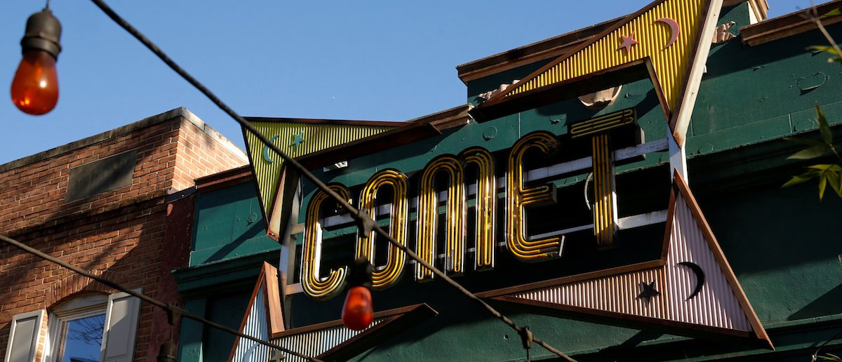 A general view of the exterior of the Comet Ping Pong pizza restaurant in Washington, U.S. December 5, 2016. The pizzeria vowed on Monday to stay open despite a shooting incident sparked by a fake news report that it was fronting a child sex ring run by Democratic presidential candidate Hillary Clinton. (REUTERS/Jonathan Ernst)