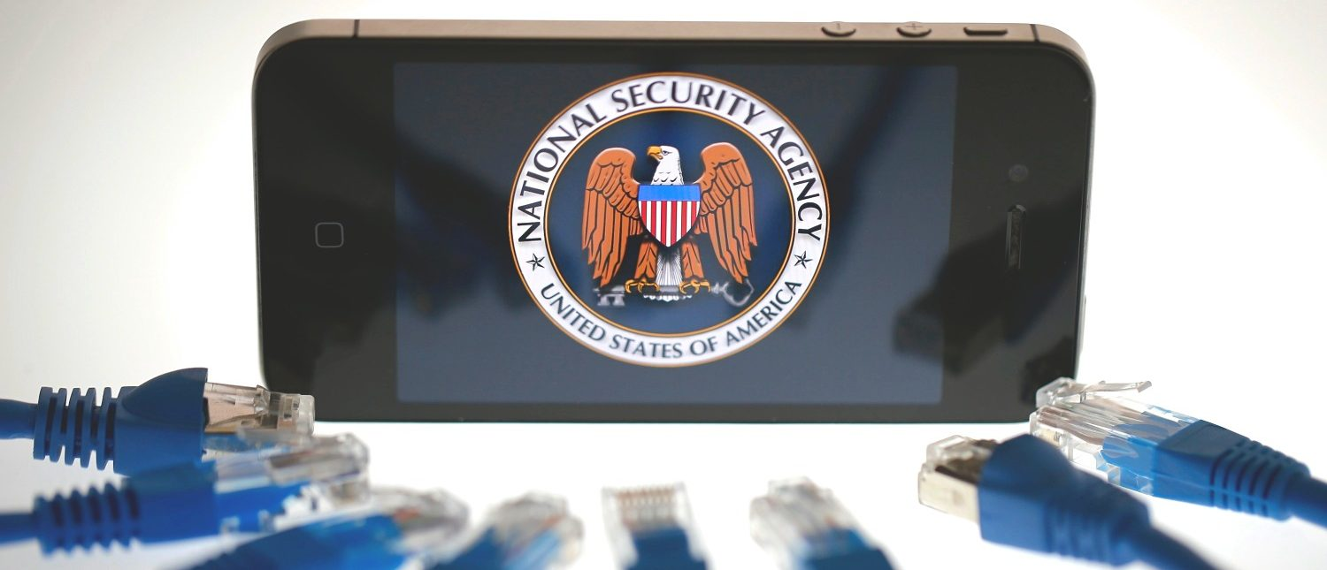 An illustration picture shows the logo of the U.S. National Security Agency on the display of an iPhone in Berlin, June 7, 2013. The debate over whether the U.S. government is violating citizens' privacy rights while trying to protect them from terrorism escalated dramatically on Thursday amid reports that authorities have collected data on millions of phone users and tapped into servers at nine internet companies.   REUTERS/Pawel Kopczynski