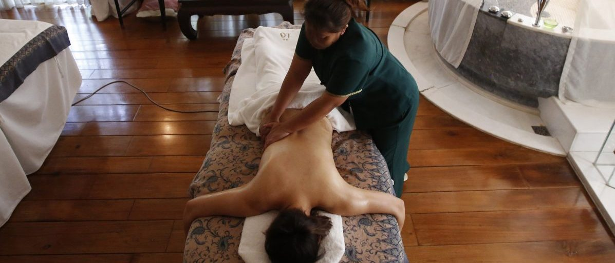 A masseuse demonstrates a full body massage treatment at a spa during a photo opportunity in Beijing July 12, 2013. In the spa which is known as one of the most luxurious spas in Beijing, the full body massage treatment in a private room with a bathtub is 2,300 RMB (about $375) per 1.5 hour. China has pledged to double household incomes over the coming decade in a bid to close a wealth gap so wide it threatens social stability. Although the proportion of extreme poverty has fallen over recent decades, about 12 percent of the country's 1.3 billion people still live on less than $1.25 per day, according to a 2013 United Nations report. Picture taken July 12, 2013. REUTERS/Kim Kyung-Hoon