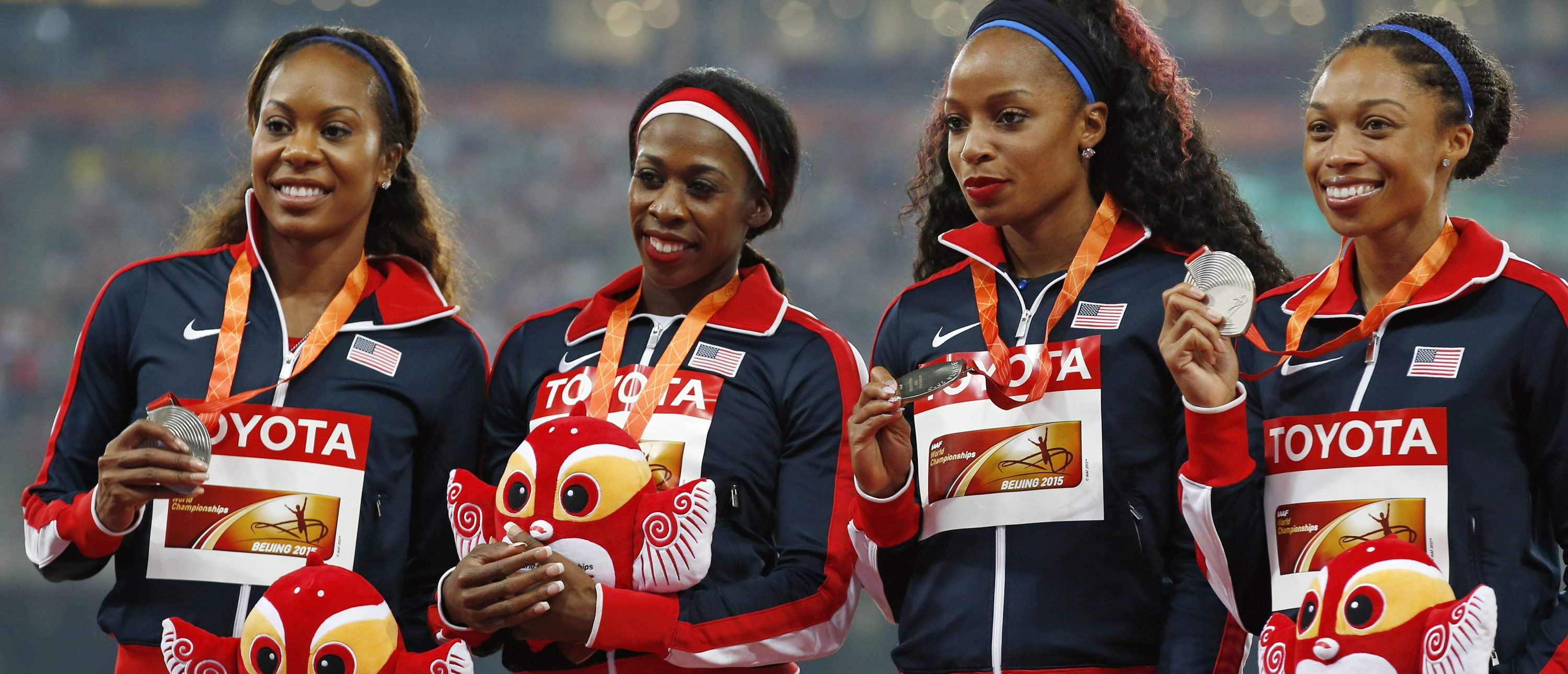 Second placed U.S. team Allyson Felix, Natasha Hastings, Francena McCorory, and Sanya Richards-Ross (R-L) present their silver medal as they pose on the podium after the women's 4 x 400 metres relay event during the 15th IAAF World Championships at the National Stadium in Beijing, China, August 30, 2015. REUTERS/Kim Kyung-Hoon - RTX1QA88