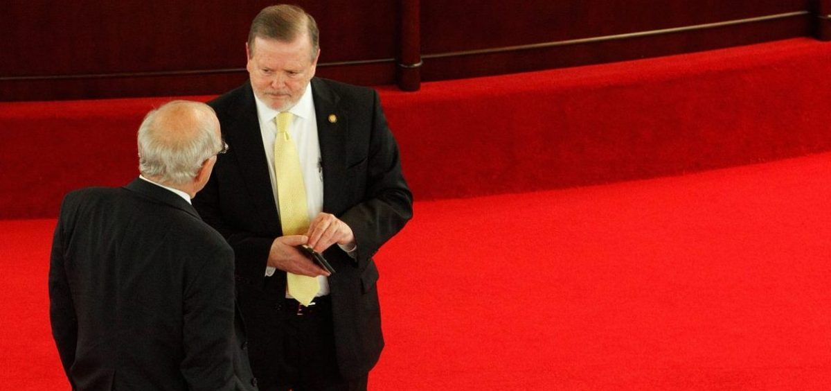 Phil Berger (R), President Pro Tempore of the North Carolina State Senate, confers with fellow Republican senator Stan Bingham on the floor of the chamber during a lull in negotiations amongst lawmakers considering repealing the controversial HB2 law limiting bathroom access for transgender people in Raleigh, North Carolina, U.S. on December 21, 2016. REUTERS/Jonathan Drake - RTX2W33J