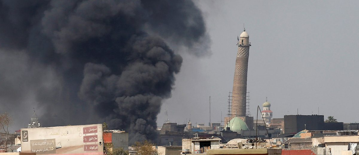 Smoke rises from clashes near Mosul's Al-Habda minaret at the Grand Mosque, where Islamic State leader Abu Bakr al-Baghdadi declared his caliphate back in 2014, as Iraqi forces battle to drive out Islamic state militants from the western part of Mosul, Iraq, March 17, 2017. REUTERS/Youssef Boudlal TPX IMAGES OF THE DAY - RTX31ICY