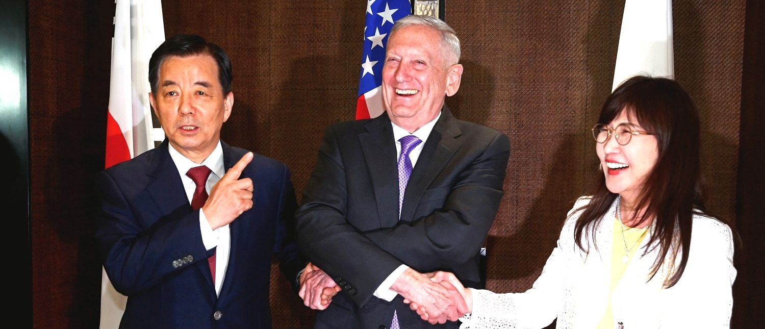 South Korea's Defence Minister Han Min-koo shows U.S. Secretary of Defense James Mattis and Japan's Defence Minister Tomomi Inada how to do a handshake during a trilateral meeting on the sidelines of the 16th IISS Shangri-La Dialogue in Singapore June 3, 2017. REUTERS/Edgar Su