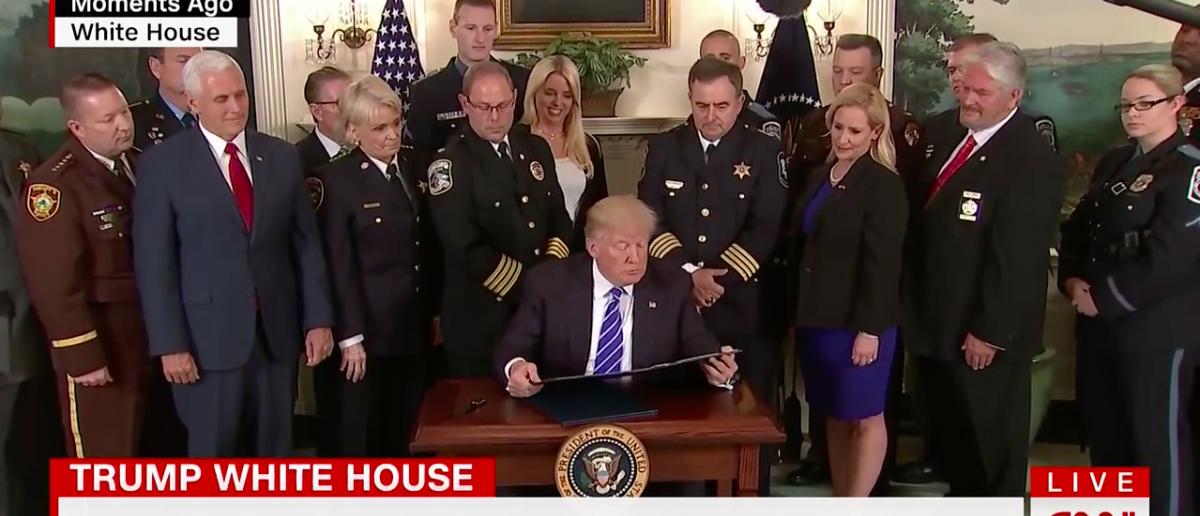 Screen Shot Trump Signs Bills For Law Enforcement and Veterans (CNN: June 2, 2017)