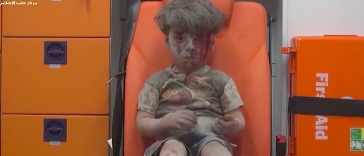 Syrian boy Omran after an airstrike in east Aleppo.(screenshot/Aleppo Media Center)