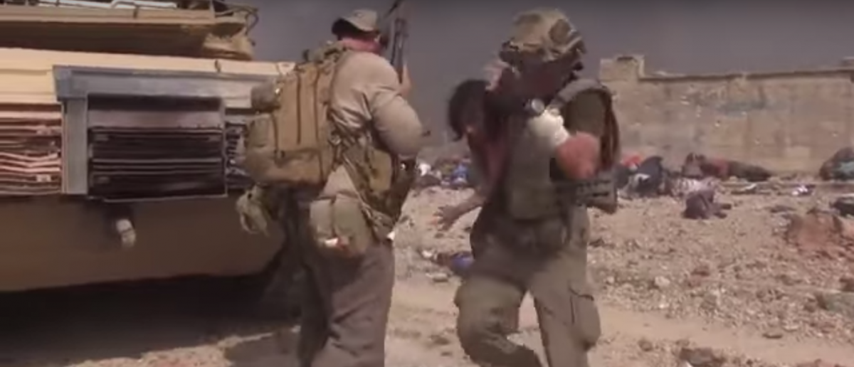 Former Special Forces soldier David Eubank saves a young girl from ISIS fire. Source: YouTube Screenshot